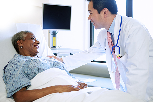 Bedside Physician with Patient